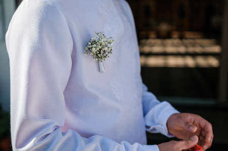 Boutonniere on the groom's jacket