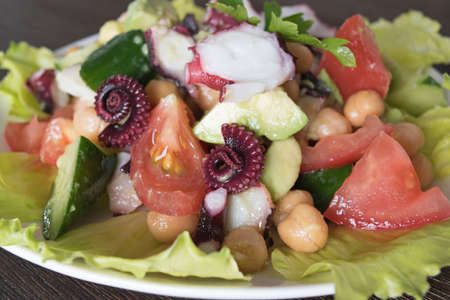 dill and parsley: Healthy salad with octopus, chickpeas and vegetables avocado tomato cucumber dill parsley