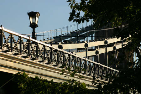 The bridge structure is an old street lamp