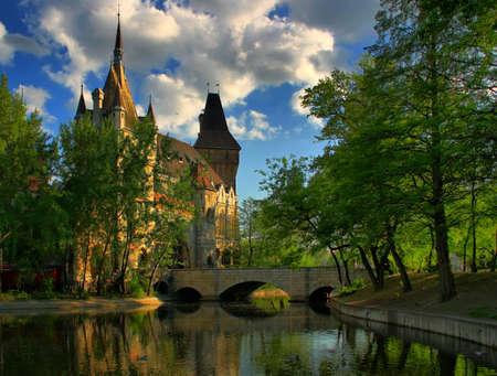 The lake around the castle bridge. Stock Photo