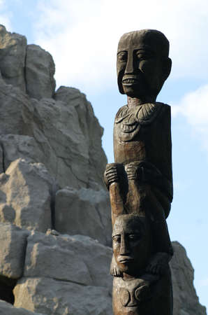 African totem column between the mountains. Stock Photo