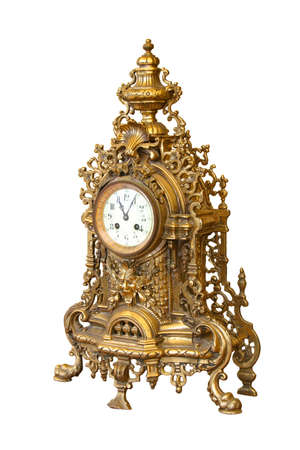 Old decorated desktop gilded clock.