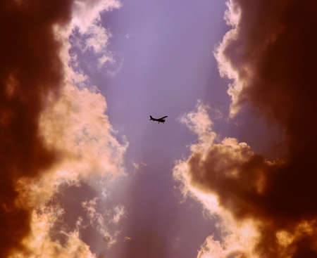 plane between the two rain clouds