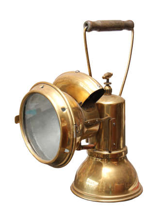 Old copper miner carbide lamp on a white background.