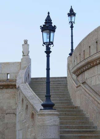 Old lights of the castle stairs rail.