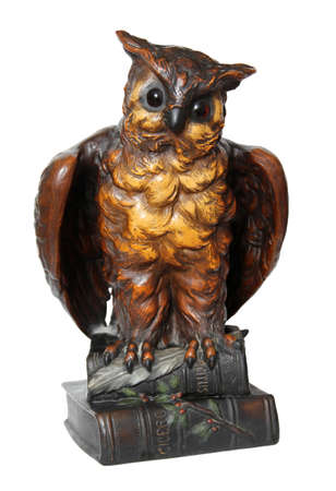 Owl statue symbolizing the learning with books. photo