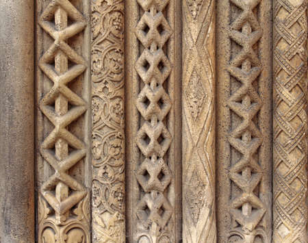 carved stone: Carved stone detail red patterned column. Stock Photo