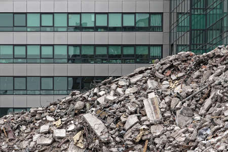 house demolition: House demolition debris next to modern buildings.