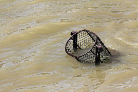 dirtiness: The street dustman is a basket in flood.