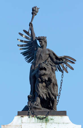 angel statue: Angel keeping a torch sculpture with a lion. Stock Photo