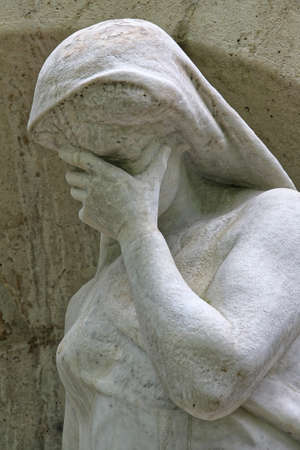 monumental cemetery: Cemetery statue symbolizing the sadness. Stock Photo