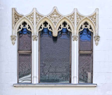 castle district: Budapest, Hungary, Buda castle district gothic windows.