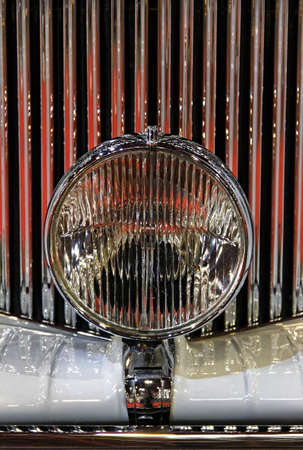 grille: Old-timer shiny grille and close-up spotlight. Stock Photo