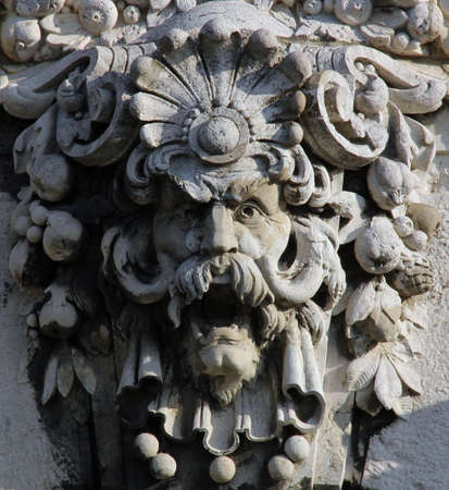 Budapest, Hungary, building facade with ornate statue head.