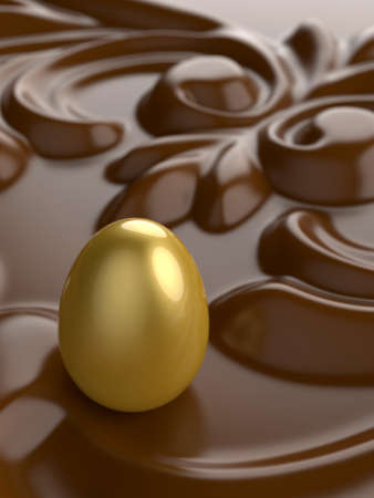 An Easter golden egg with chocolate ornament in front.