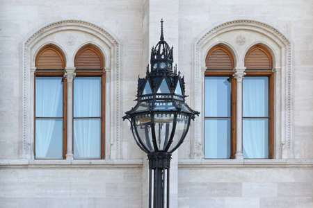Street lamp in front of two windows of Parliament in Budapest, Hungary.