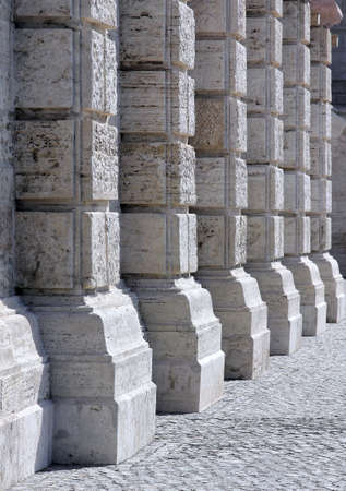 Stone colonnade background.