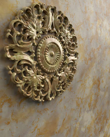 Marble wall with round stone ornament.