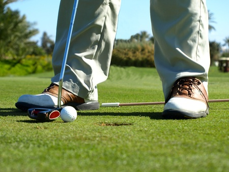Golf club: golfer concentrating on the 18th hole    photo