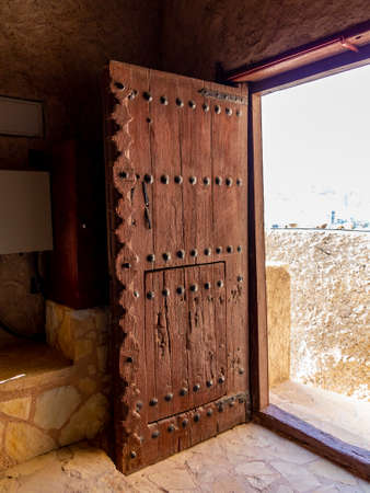 Massive antique door in Fort Muttrah in Muscat, the capital of Oman Stock Photo