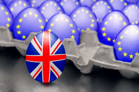 Concept of Brexit is presented from jumping egg with a British flag out of the box with eggs with the flag of the European Union