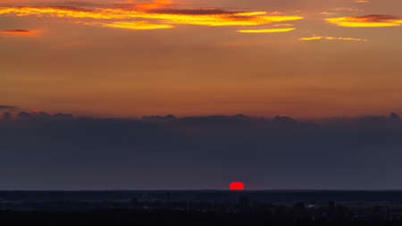 Panoramic view of the horizon and colorful sunset on the outskirts of the city