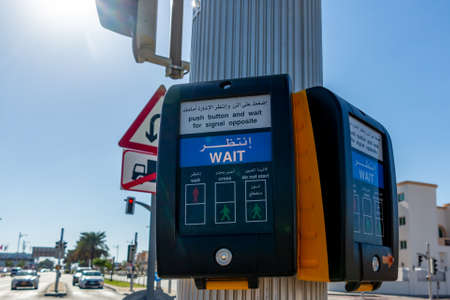 Dubai, United Arab Emirates - December 12, 2018: modern button for pedestrians at the intersection with the words wait Editorial
