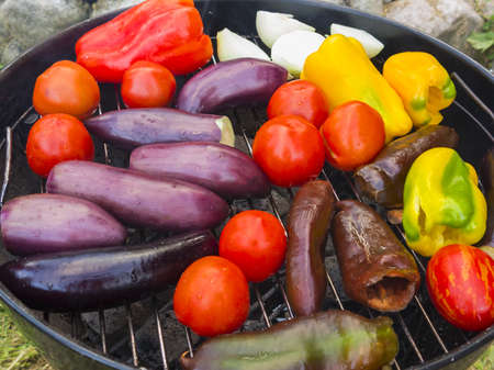 Cooking vegetables on a round grill outdoors in summer