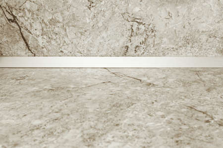 Empty kitchen countertop and a wall of light marble. Mockup to showcase your product Stockfoto - 123217812