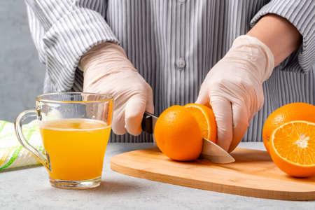 Woman slicing oranges for making fresh juice