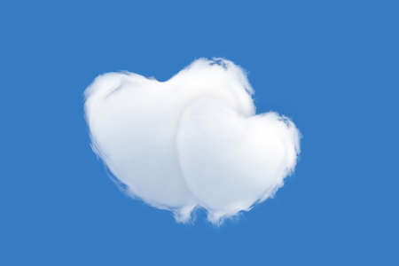 Two clouds in the shape of a heart isolated on a blue background - love and tenderness concept