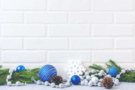 Christmas composition - decorations and fir branches on a light background with space for text