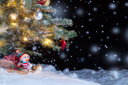Christmas composition - Christmas tree in the snow, gifts, toy snowman and the inscription Merry Christmas and Happy New Year, copy space, place for text Stok Fotoğraf