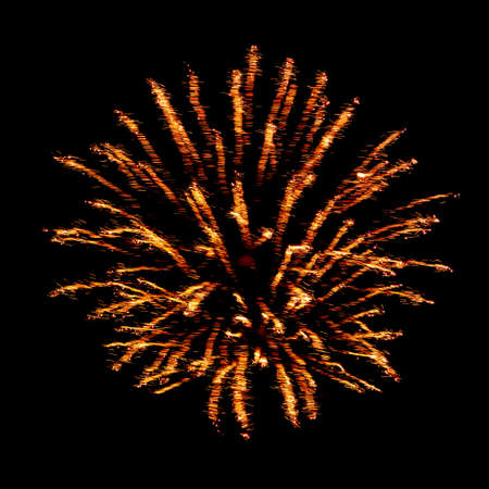 Orange flash and sparks from fireworks isolated on black background 스톡 콘텐츠