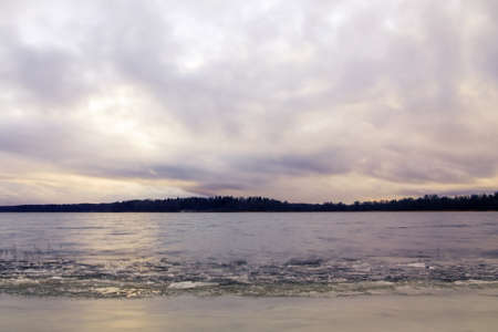 first ice on the lake in late autumn. Winter Coming Landscape