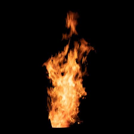 Bright bonfire flame isolated on black background. Banco de Imagens