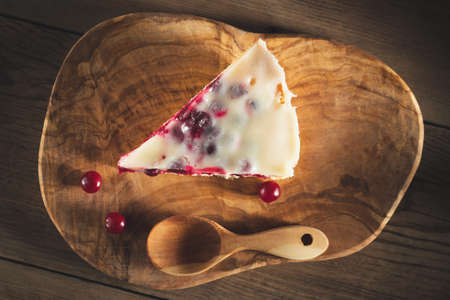 Homemade cake with cranberries and sour cream. Piece of pie close up, top view