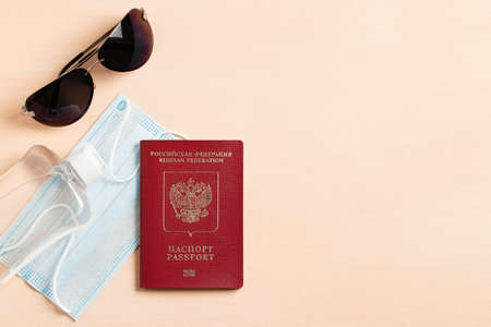 Safe travel during coronavirus pandemic concept. The inscription in Russian means passport and Russian Federation. Copyspace, flatlay