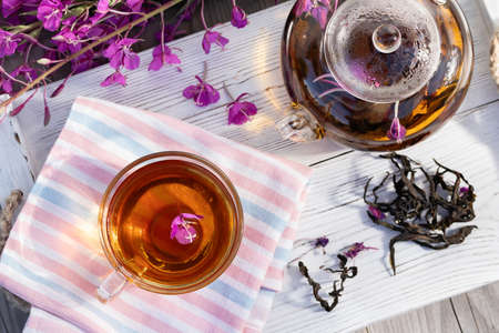 Herbal tea made from fireweed known as blooming sally in teapot and cup, top view