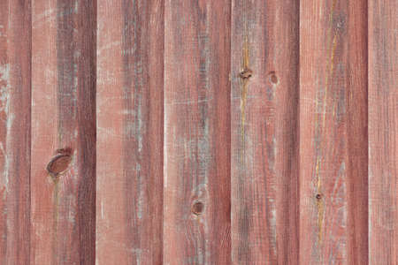 Surface of the old wall sheathed with wooden boards, wooden background, texture