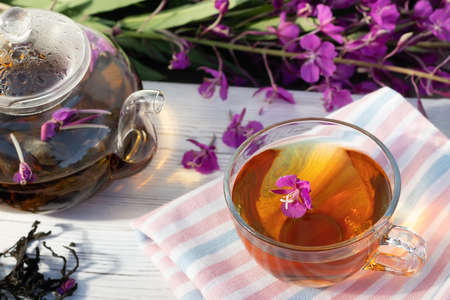 Herbal tea made from fireweed known as blooming sally in teapot and cup 免版税图像