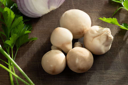 Cooking edible puffball mushrooms. Several whole mushrooms on a cutting board