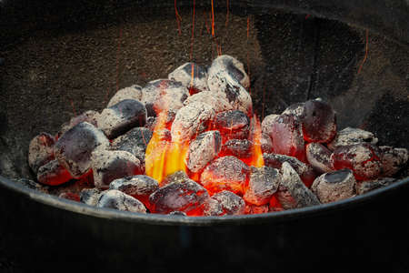 Hot charcoal in a round barbecue grill 免版税图像