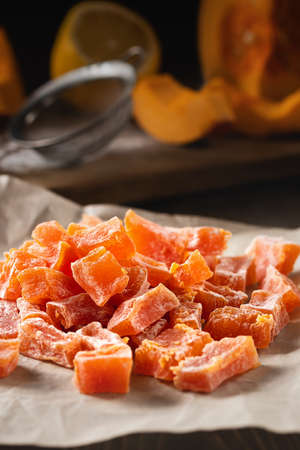 Cooking Natural farm homemade candied pumpkin fruits sprinkled with powdered sugar