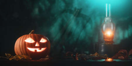 Halloween pumpkin head jack lantern with glowing eyes and kerosene lamp on wooden table 免版税图像