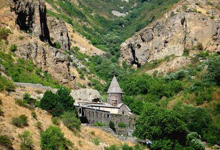 caved:  geghard monastery in armenian mountains