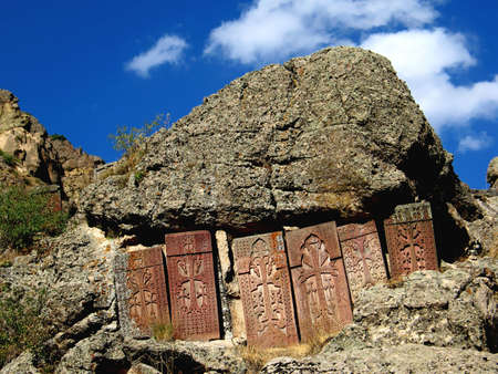 caved:  cross stones in geghard monastery,armenia Stock Photo