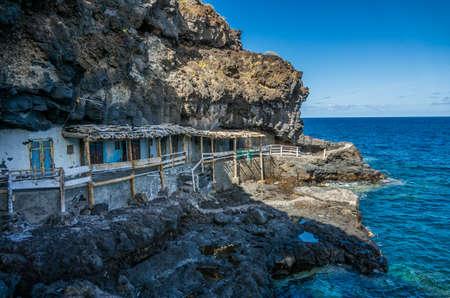 Fishing village caves in La Palma coast Stock Photo