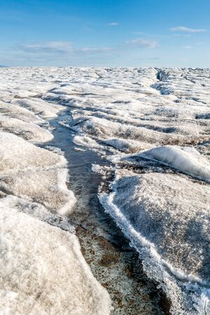 Melting ice in top surface of a glacier, Svalbard