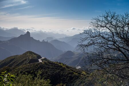 Roque Nublo mountain with clouds, Canary Islands